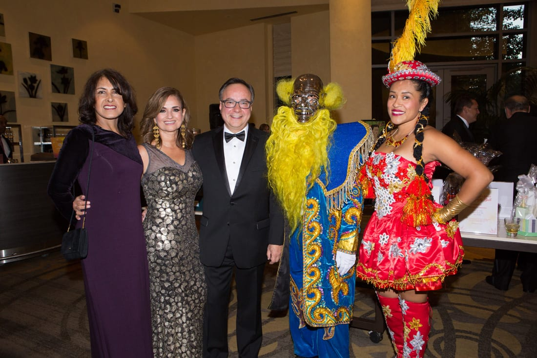 Patricia Hunt, Omarira Diaz, Gabrial Vaca with costumed performers