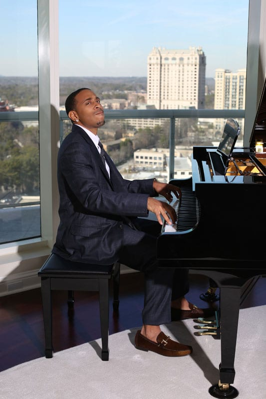 STRIKING A CHORD With a captivating Buckhead backdrop, Luda serenades the Simply Buckhead crew at the cover shoot.