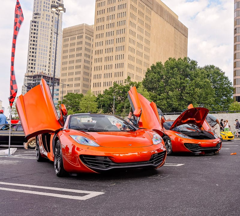 A pair of orange McLarens  exemplify the exotic vehicles stopping traffic at the monthly Caffeine & Exotics car show. -Caffeine and Exotics - August 2014