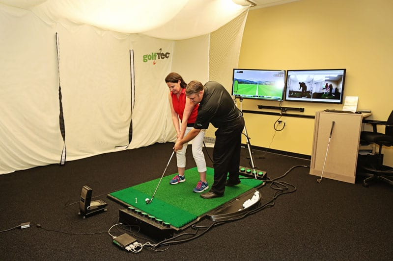 The author working on her golf swing with GolfTEC Atlanta's patented swing analysis technology.