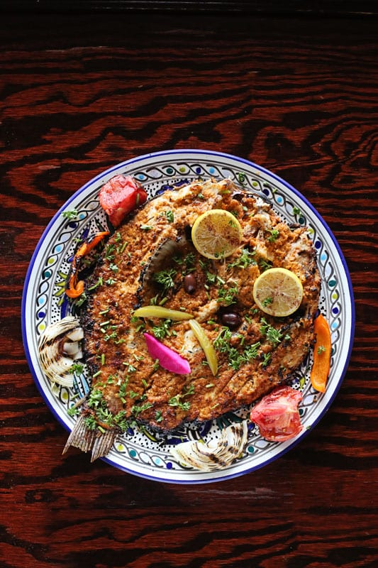 Babylon Café's samak masguf—a whole grilled wild tilapia sprinkled with sumac and breadcrumbs and plated with onion, tomatoes and beets—is a stunner.