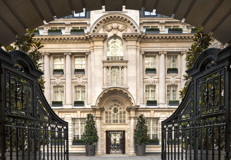 The Rosewood's wrought iron gates beckon guests to visit the only hotel grand courtyard in London.