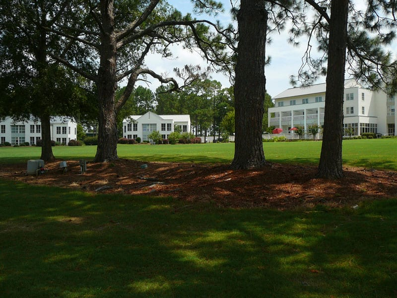 The inn and villas of Blackshear Resort look out over a lawn that sweeps down to the water's edge.