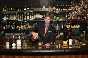 Caleb Hopkins runs the beverage program at Atlas, and he always dresses as elegantly as he pours.