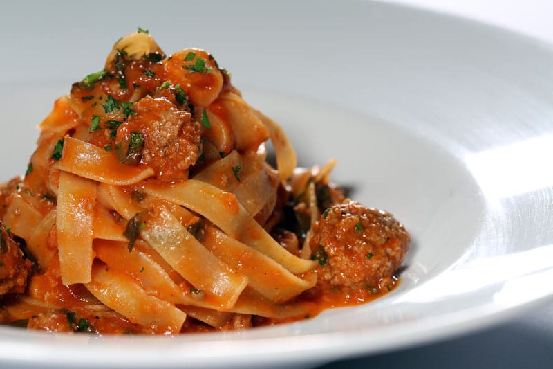 Davio's tagliatelle is smothered in a classic Bolognese sauce, made from braised veal, beef, pork and tomato.