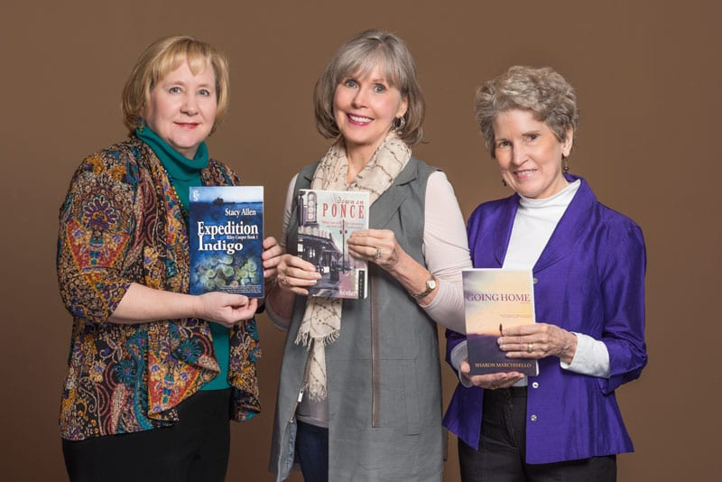 Lisa Malice (far left), Anne Lovett Sullivan (center) and Louise Richardson are part of the Sisters in Crime Atlanta chapter whose members are working on their own stories as well as reading some of the newest books in the genre.