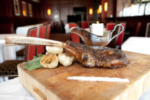 The Bull & Bear's dry-aged tomahawk ribeye weighs in at a hefty 38 ounces.