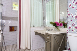 Lindquist's bathroom, done in neutral tones and a cherry blossom wallpaper, was expanded during the renovation by taking over a closet from an adjacent room.