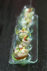 Start your experience with slivers of yellowtail in a bright sauce, served in fun shot glasses.