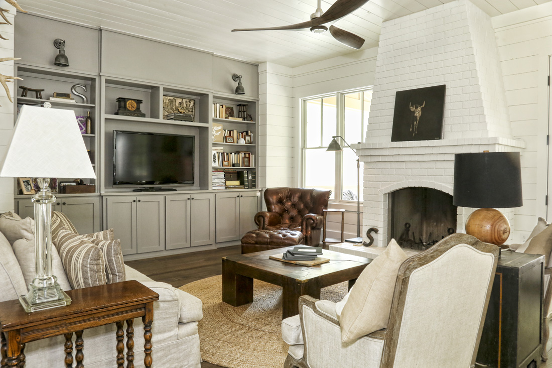 Painted white brick and shiplap are two classic building materials used in the Schoenith home. The family room is a grand example of Ashley's favored neutral palette.
