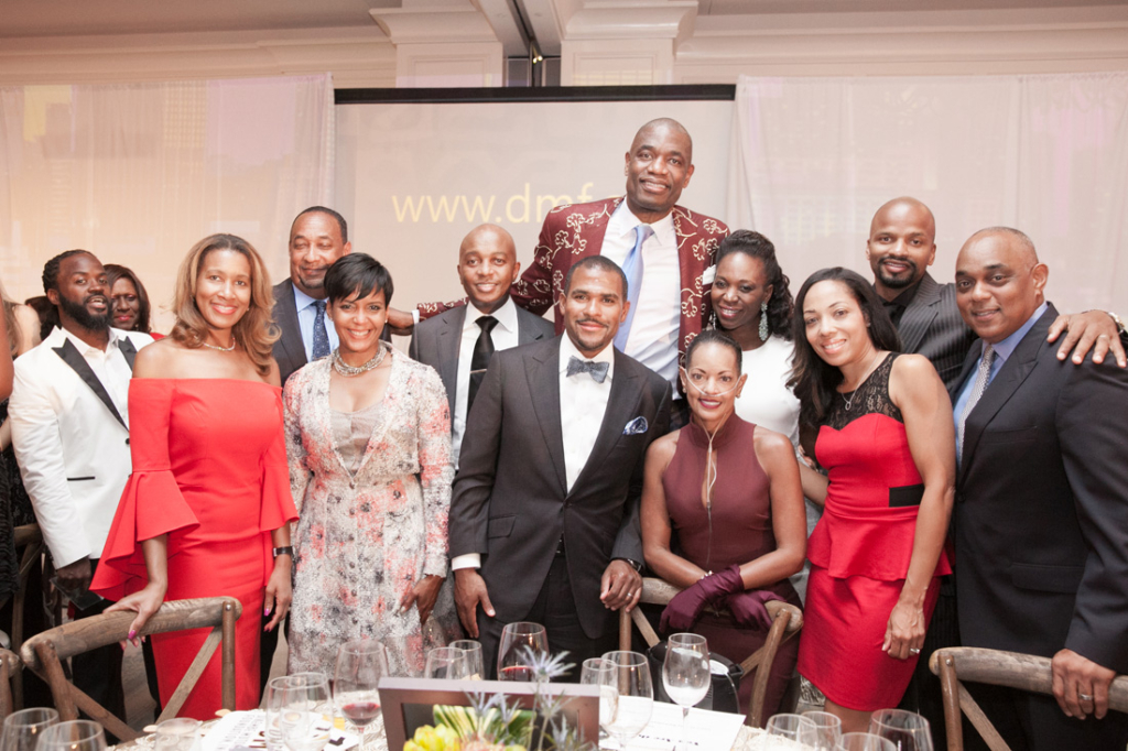 Dikembe Mutombo (center) with (left to right) Genise Huey, Derek Bottoms, Keisha Lance Bottoms, Dr. Jarrod Huey, Chris Twyman, Lovette Russell, Tashia Twyman, Nikkya Williams, Travis Williams and Michael Russell.