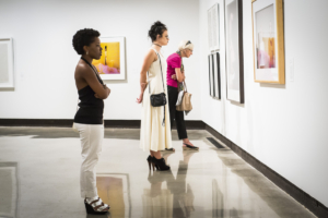 Visitors to SECCA, one of only two contemporary art museums in North Carolina, peruse the works on display.