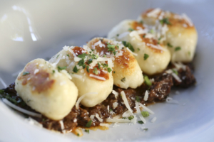 Fork-licking, impossibly tender lamb and beef sugo topped with ricotta gnocchi.