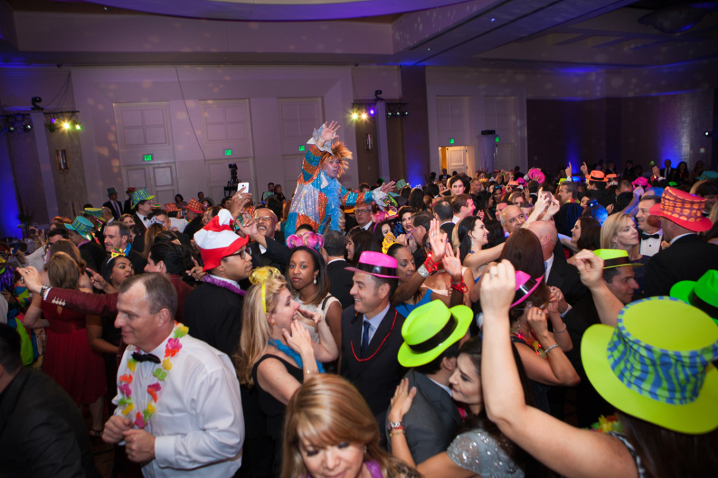 "The lively crowd parties during the carnival-inspired ""La Hora Loca."""