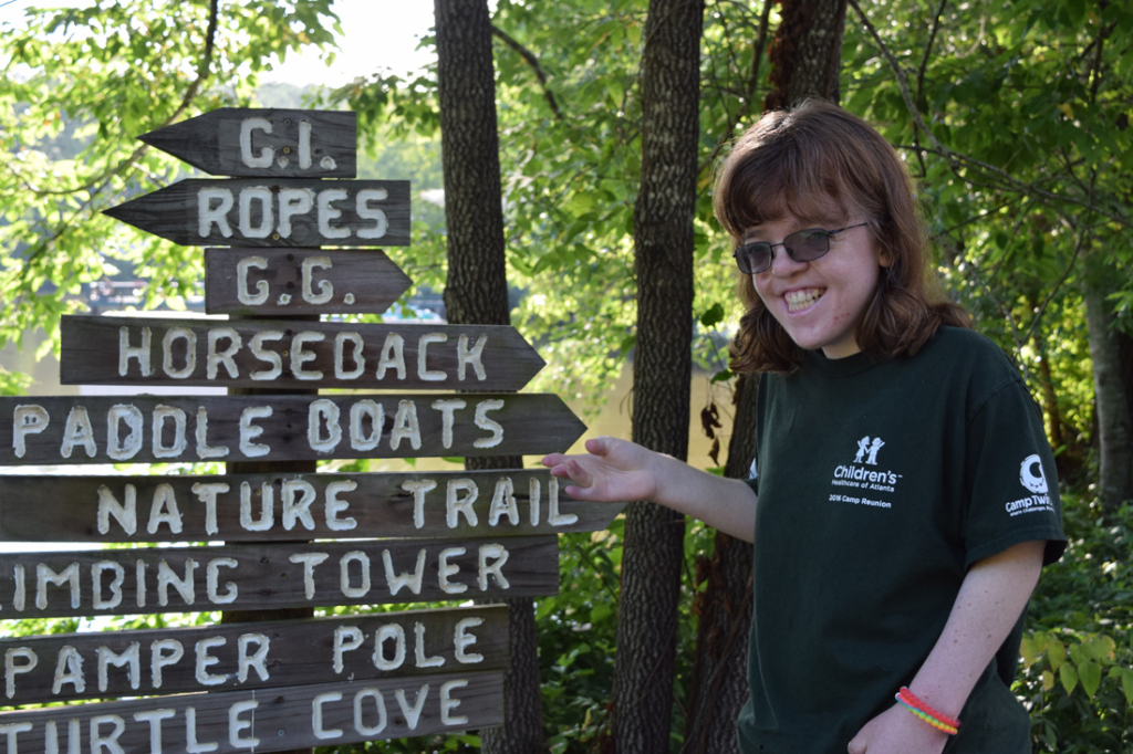 Morgan McGahan points to all the activities she loves at Camp Twin Lakes.