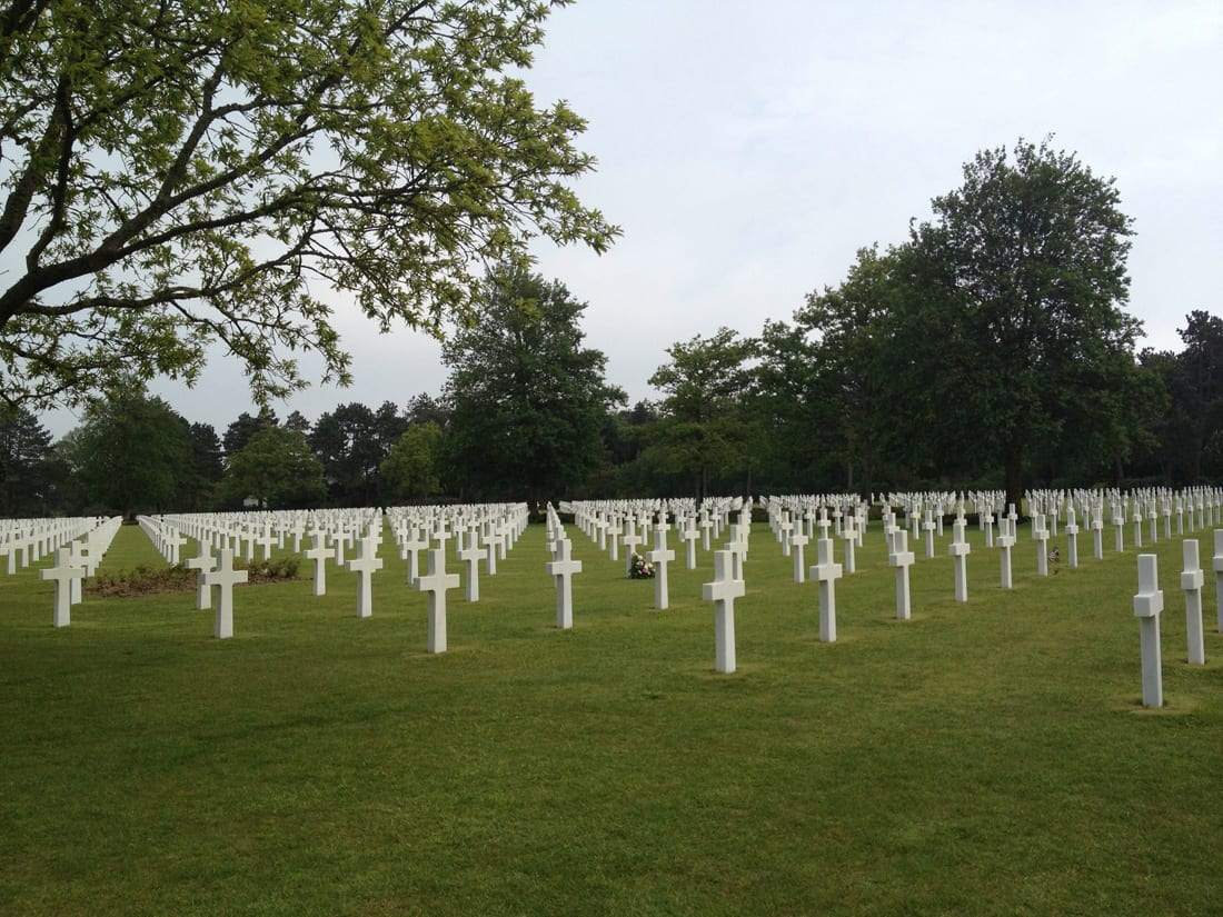 The rows of white crosses at the American Cemetery in Normandy face west, toward the U.S.