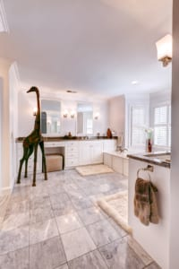 A whimsical giraffe greets visitors in the second floor guest bathroom.