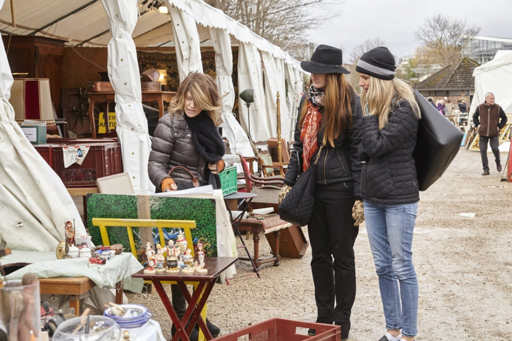 Linda Mohan (far left), manager of Huff Harrington Fine Art, helps shoppers uncover hidden gems during a March buying trip to Paris.