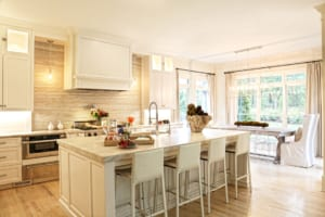 The light-colored kitchen is the heart of the Xerogeanes home and where John cooks Sunday dinners.