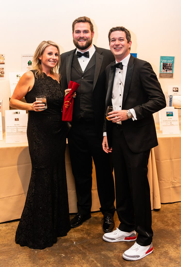 Simply Buckhead Magazine Enduring Hearts Bourbon Gala & Auction February 15, 2019 From left: Bethany Chatterjee, Nick Stone and Jeff Williams  Photo Credit: Henri Hollis