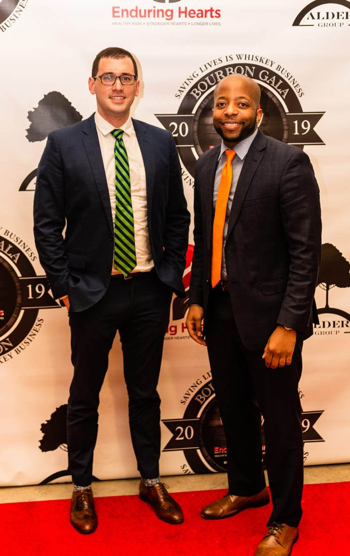 Simply Buckhead Magazine Enduring Hearts Bourbon Gala & Auction February 15, 2019 Grant Mannion (left) and Corey Raines (right) of the Raines Legal Group.  Photo Credit: Henri Hollis