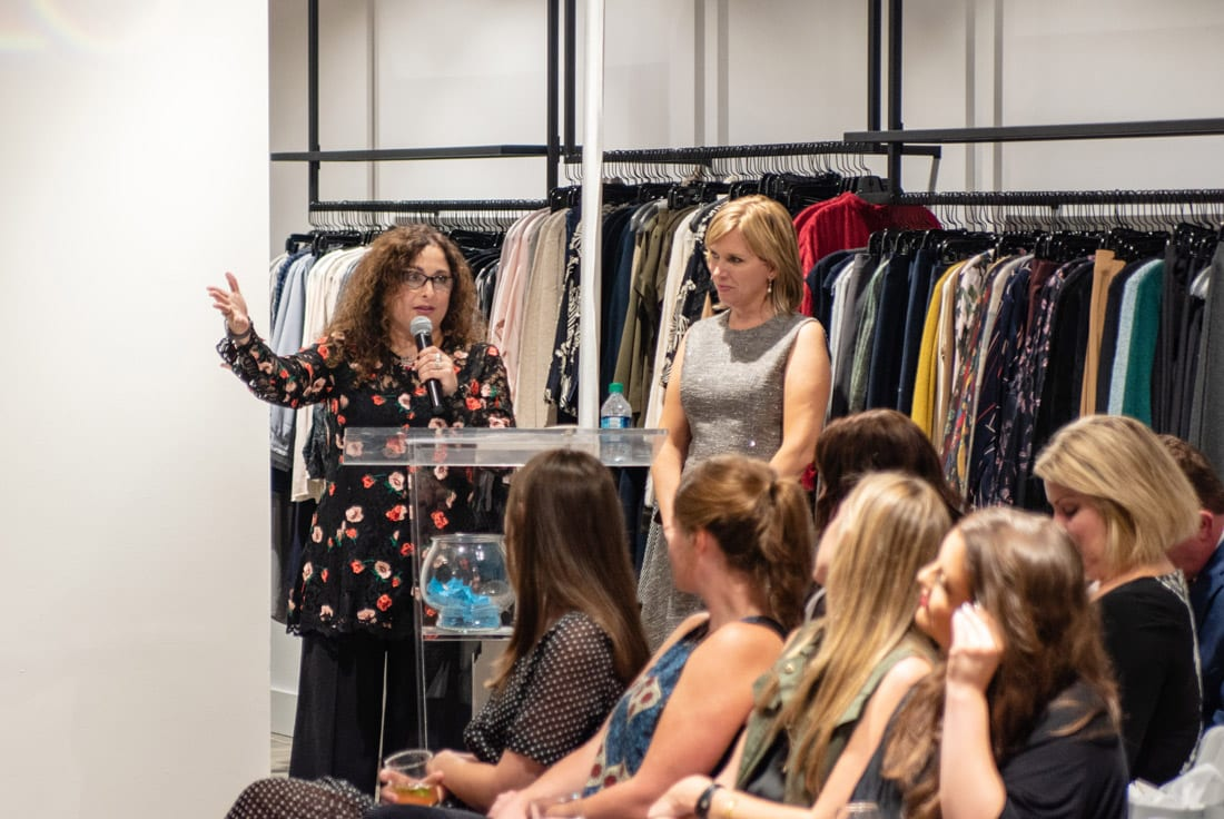 Simply Buckhead ACFB Fall for Fashion 2018 September 25, 2018 Caption: Sara Mixon, Manager of Tootsies (left), gives details on the Fall 2018 looks being modeled on the runway while 11Alive reporter Jennifer Leslie emcees. Photo credit: Henri Hollis