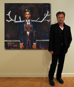 John Mellencamp showcasing one of his paintings on display at Augusta's Morris Museum of Art.