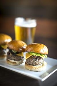 Beef sliders with housemade bourbon-bacon jam shine on H&F Bread buns at Buckhead Tavern.