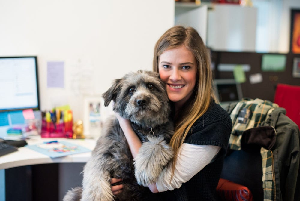 Beth Irwin cuddles up with the unofficial office mascot, Annie. The president of Brown Bag Marketing, Doug Brown recently rescued Annie, and everyone in the office loves her!