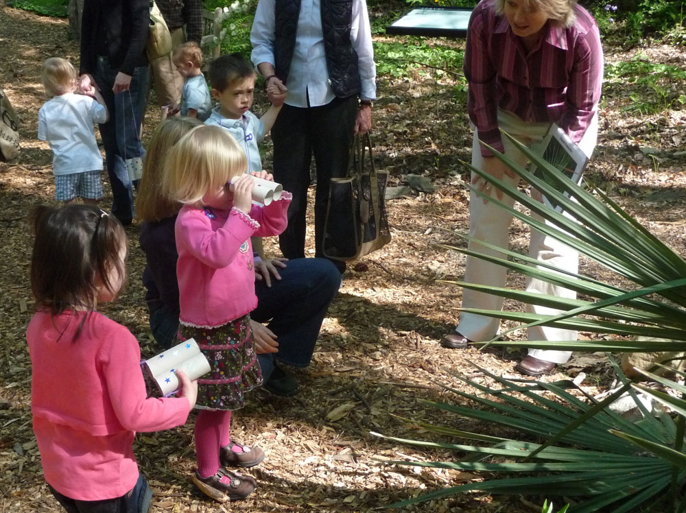 Toddlers learn about plants and how to grow them at the Atlanta History Center's Quarry Garden.