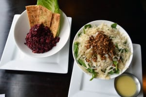 """Plum Café's """"pick two"""" salads: beet and carrot quinoa and the original pear and arugula."""