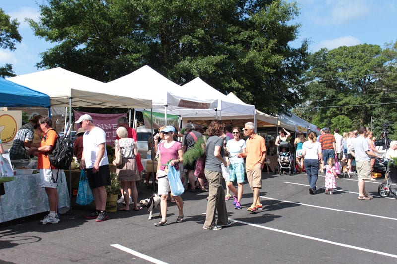 Shoppers peruse goods at the Peachtree Road Farmers Market.