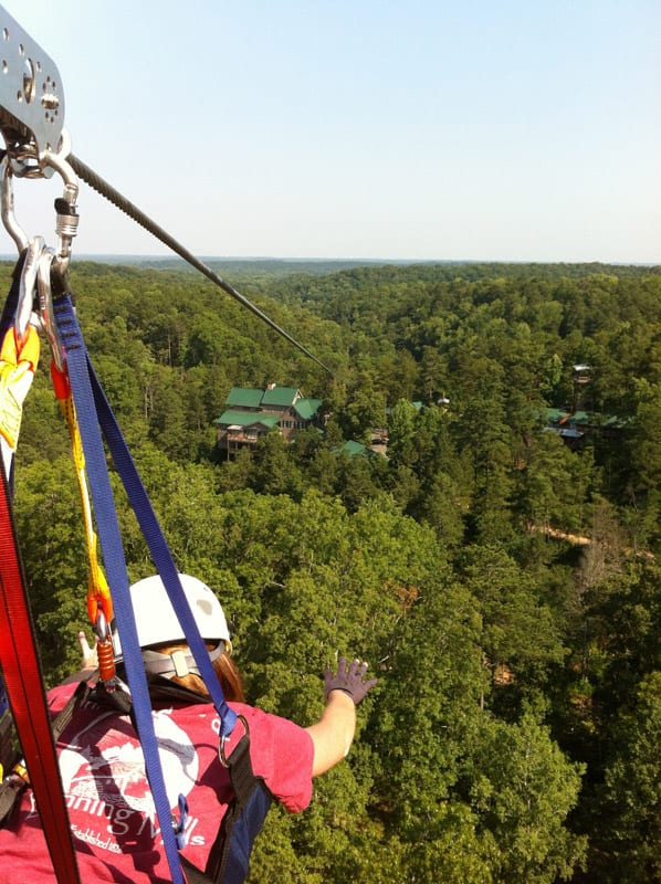 Look, Ma! No hands! The more intrepid riders of the Banning Mills zip lines soar like the birds over the tree canopy.