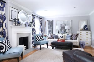 The Metzlers' living room is furnished in a kid- and poochfriendly leather couch from Rooms To Go; a campaign dresser from Goodwill that Heather painted white; and comfy blue chairs.