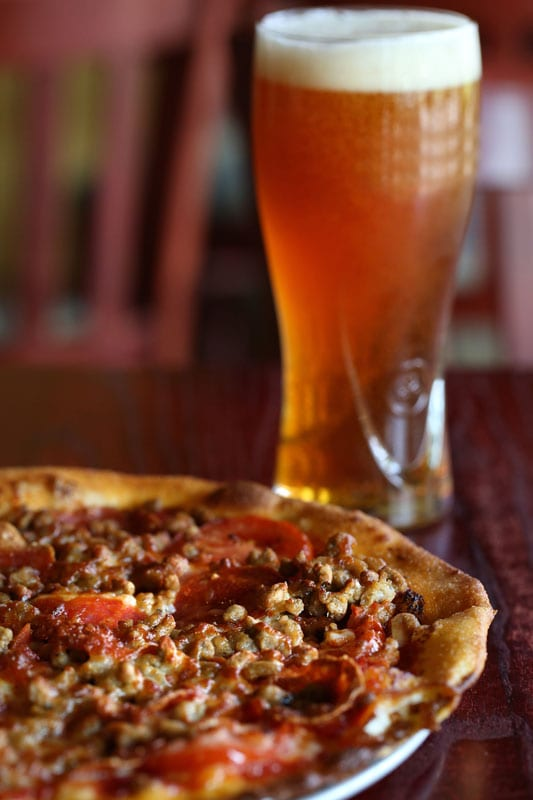 Newks' sausage-andpepperoni pizza is an irresistible mess of meat and gooey cheese.