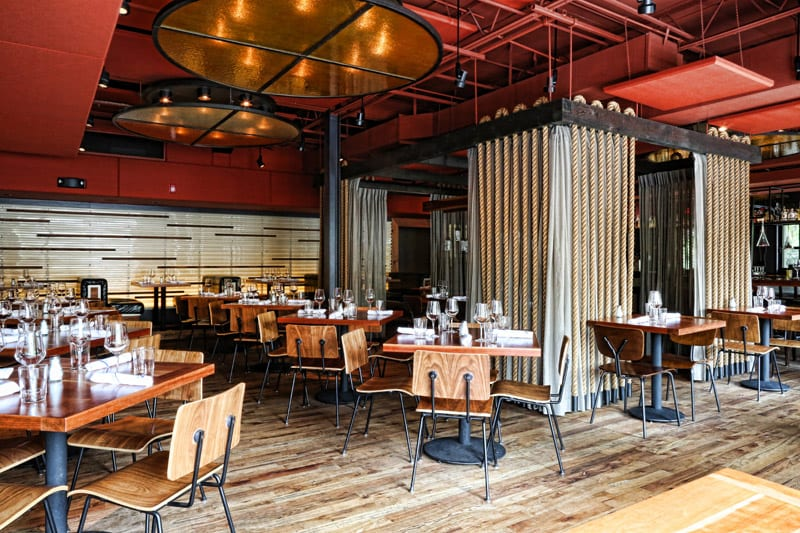 The Johnson Studio provided the contemporary look of KR SteakBar—industrial warmed up with lots of woods.