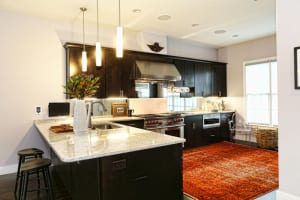 The kitchen was brand-new when Dow moved in, and prop stylist Giana Shorthouse found a handwoven, orange-dyed Pakistani rug to bring a splash of warmth and color to the open space.