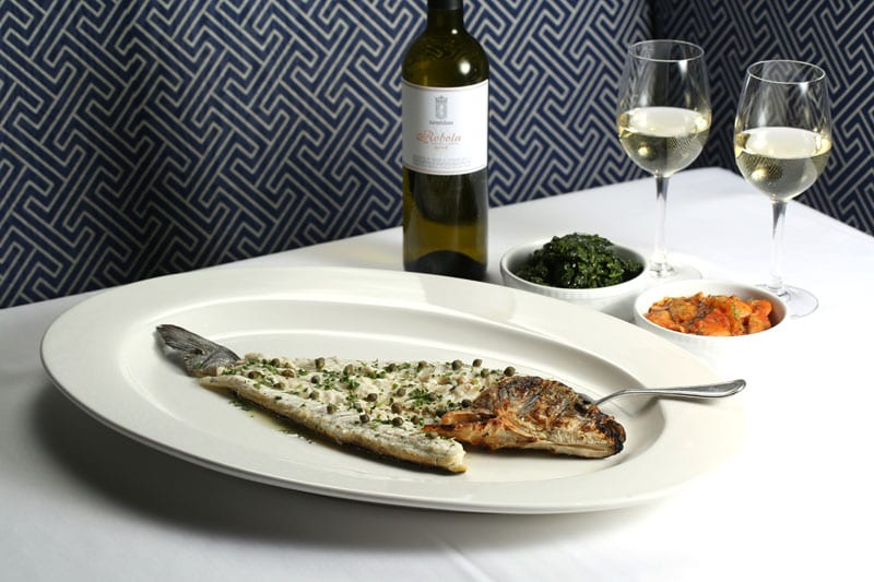 Whole roasted fish is one of the signature experiences of Kyma. To go with it: Kale and a stew of giant white beans and tomatoes.
