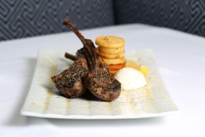 Grilled lamb chops, with a stack of potatoes and a mound of cucumber yogurt tzatziki, are pure bliss.