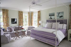 Awash in pale purple, the Bell's daughter Hannah's feminine, light-filled bedroom is one of the only spaces that deviates from the home's otherwise earthy palette. Like many things found throughout the house, Jennifer Bell repurposed the drapes from the couple's Atlanta home.