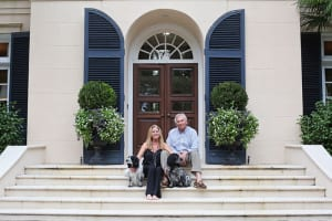 Jennifer and Tom Bell and their precious pups at home on Sea Island.