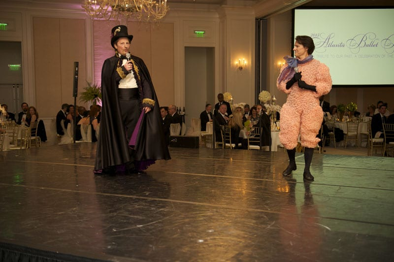 "Chris Casey and Doug Weiss, 2015 Chairs of the Atlanta Ballet Ball, stand center stage and welcome guests in costumes from the Atlanta Ballet's ""Nutcracker."""