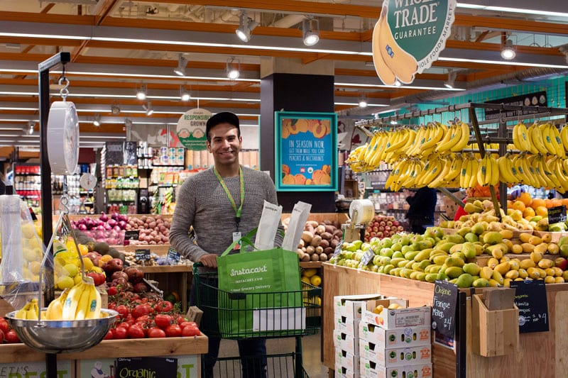 Instacart sends its shoppers to pick up groceries (seen here at Whole Foods Market) for clients who place their order online.