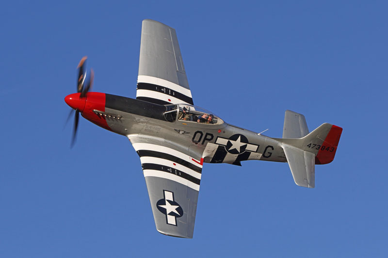 "A P-51D Mustang ""Red Nose"" soars into the wild blue yonder."
