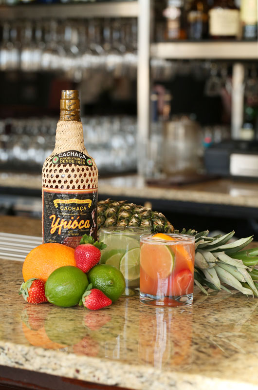 The only way to get things started at Chama Gaucha are with caipirinhas, such as classic lime (left) or tropical fruit (right).