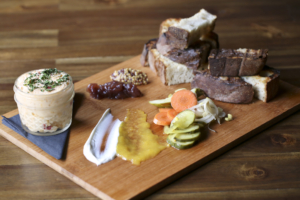 1Kept's pimento-cheese board comes with jam, mustard, pickles and grilled sour dough—and is always a hit.