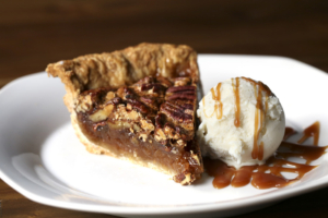 Pecan pie is deliciously old fashioned, with a scoop of vanilla and a drizzle of caramel.