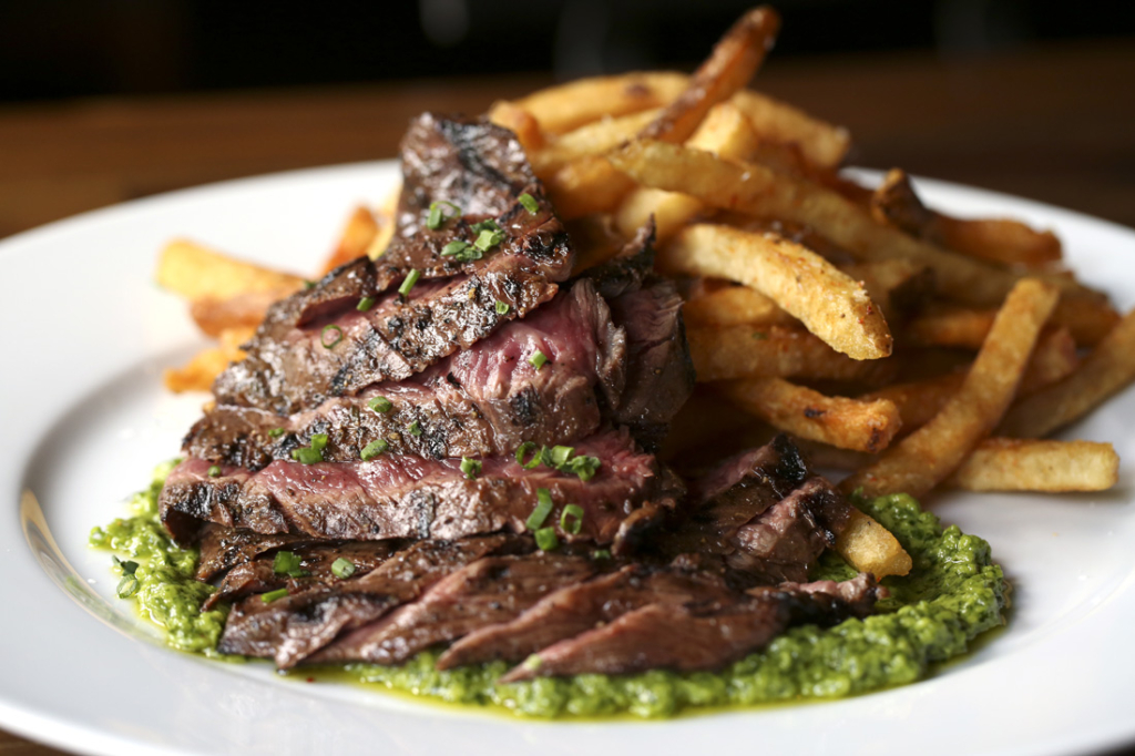 1Kept's cabernet-marinated steak-frites comes with chimichurri and awesome fries.