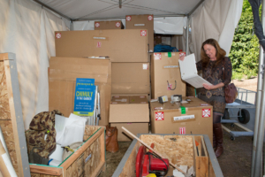 Mary Pat Matheson stands amid boxes filled with contents that will be transformed into Dale Chihuly's glass installations. The first Chihuly exhibit at the Atlanta Botanical Garden put the fledging attraction on the map, and Matheson says this new exhibit is destined to break attendance records.