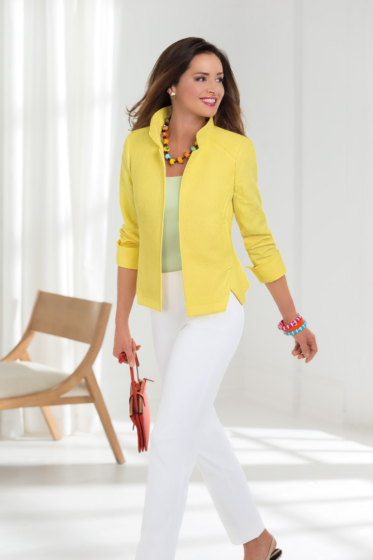 This yellow and white ensemble is an example of Nina McLemore's travel-friendly fashions.